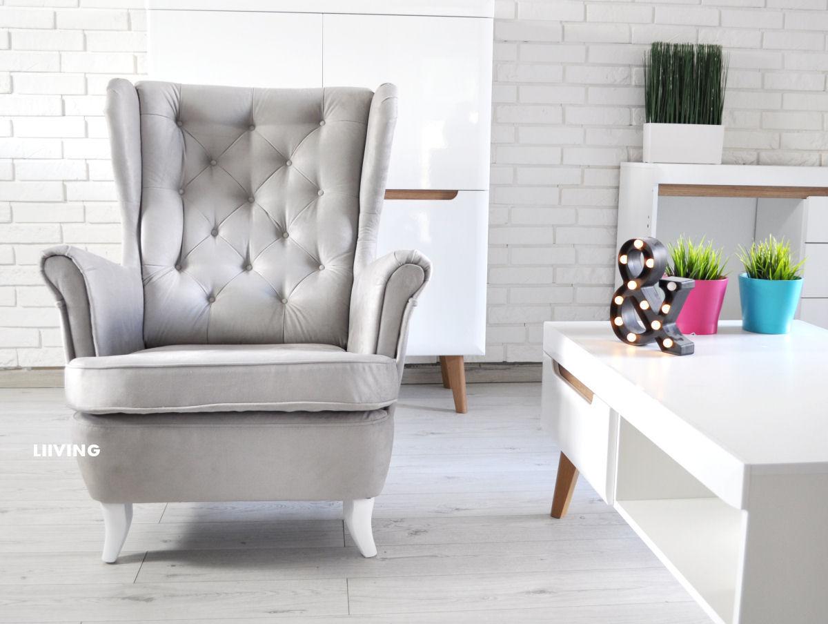 fotel uszak w jasno szarej tkaninie