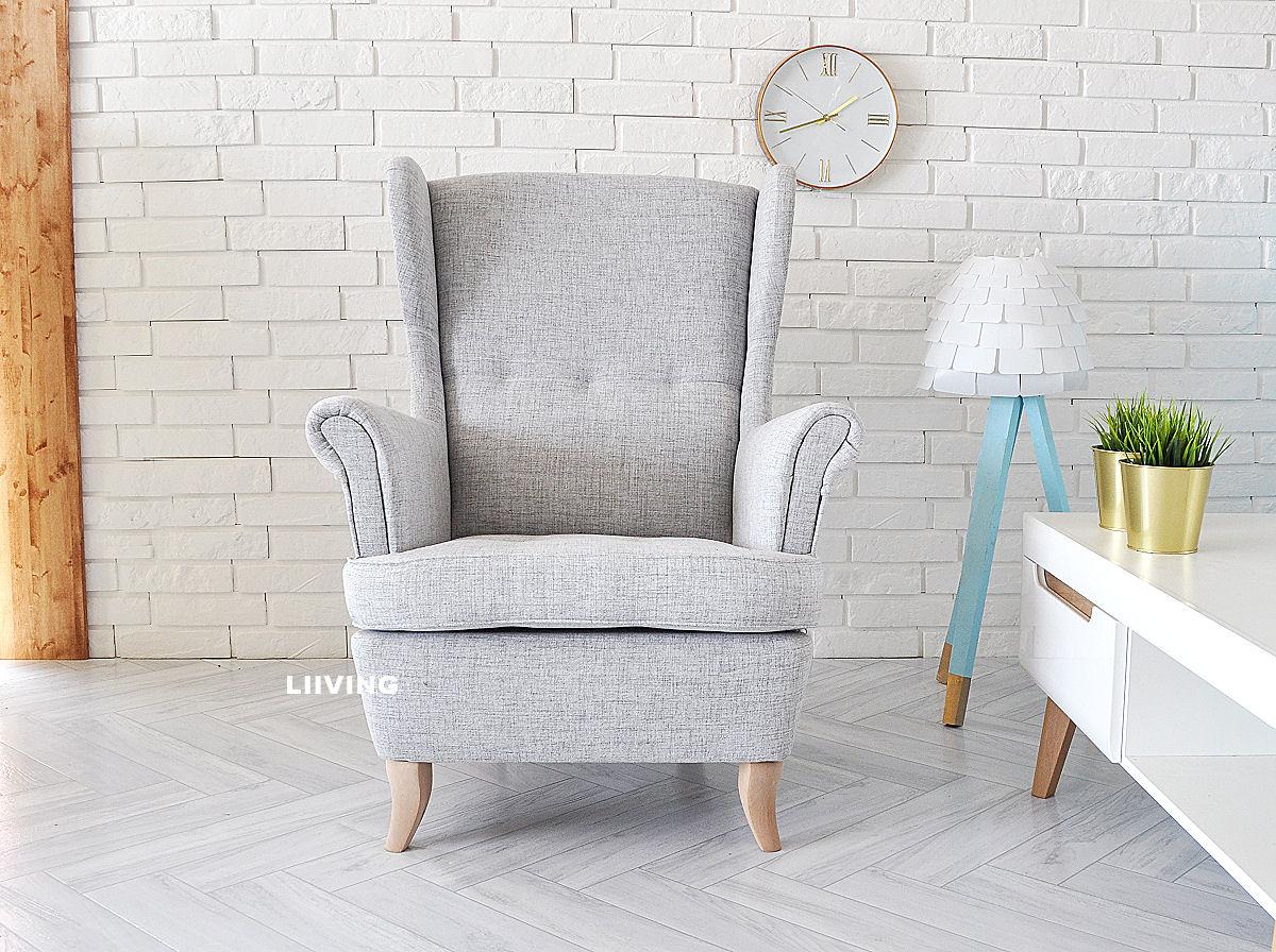 fotel uszak w jasnos zarej tkaninie